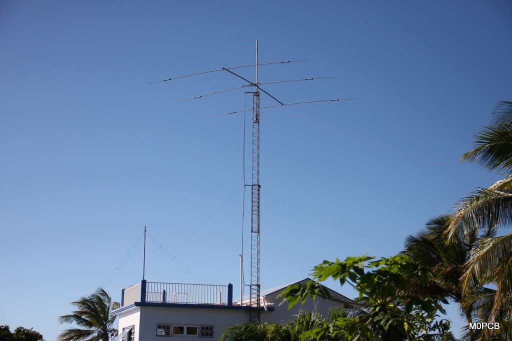 Gingerbread Hill has a 50 foot tower and a CL33 Yagi. 80m, 40m dipoles on the tower and the WARC dipole on the small pole on the left.