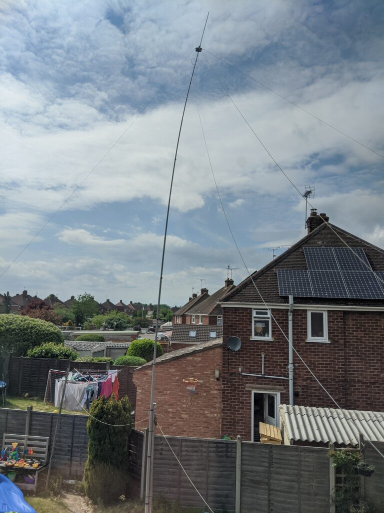 A picture of the antenna and pole in the garden.